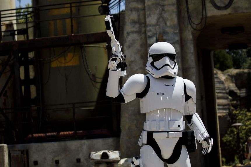 A Stormtrooper stands in front of a TIE interceptor during a media preview of Star Wars: Galaxy's Edge on May 29, 2019.