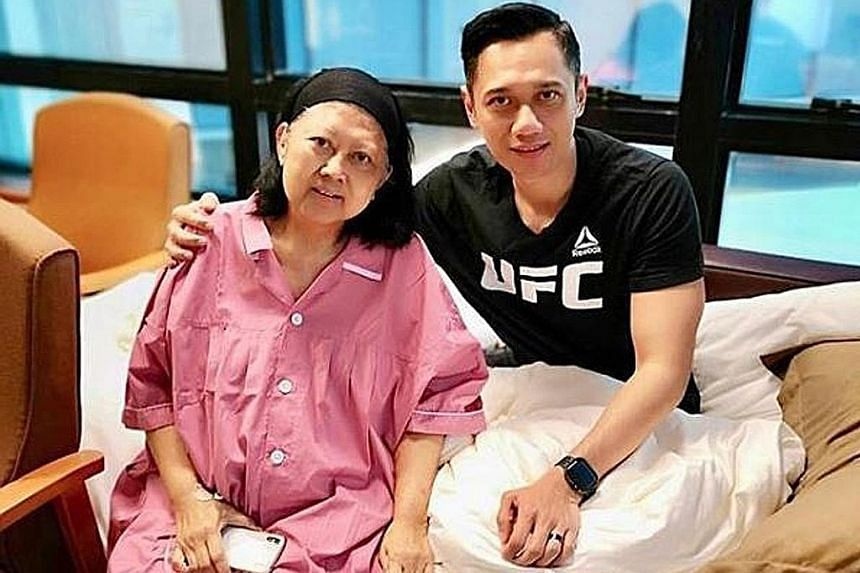 Former Indonesian first lady Ani Yudhoyono with her son Agus Harimurti Yudhoyono at NUH in Singapore in April.