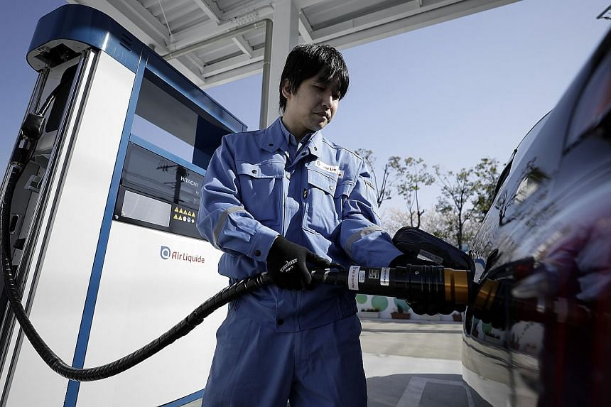 A hydrogen pump attendant at the Kawasaki Hydrogen Station, operated by Air Liquide, in Japan's Kanagawa prefecture.