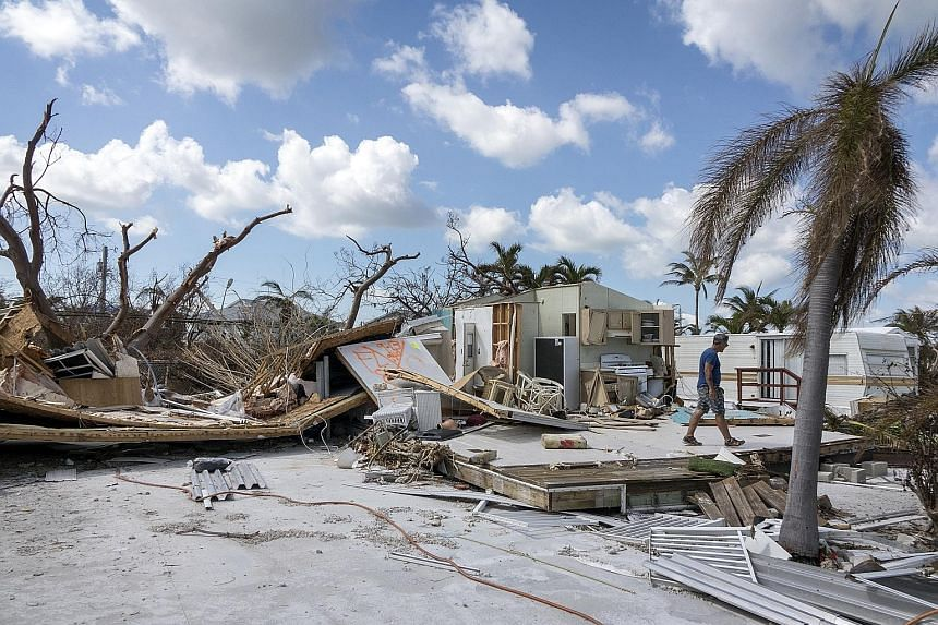 """Above: Ms Rhonda Haag says the community will adapt as much as it can to the rising seas. ST PHOTO: NIRMAL GHOSH Far left: Debris deposited at a Florida Keys resident's home in the aftermath of Hurricane Irma in 2017. PHOTO: EPA-EFE Left: """"Nuisance f"""