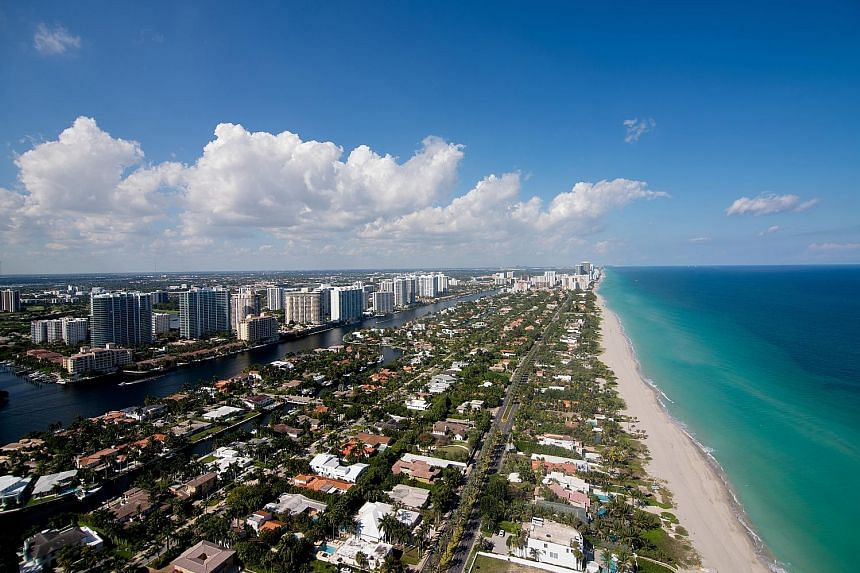 Above: A home in Florida's Vilano Beach which collapsed when Hurricane Irma struck in 2017. PHOTO: NYTIMES Far left: The view from a luxury condominium in Miami Beach. A 2016 study found that a 1.8m sea-level rise would inundate areas currently home