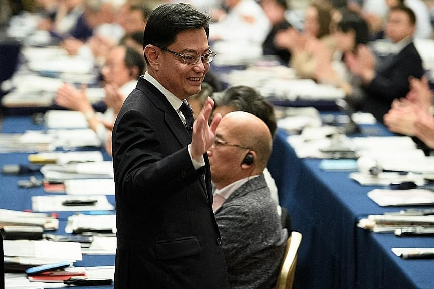 """Deputy Prime Minister Heng Swee Keat leaving after his speech at the Nikkei Future of Asia conference in Tokyo on Thursday, where he called on the US and China to """"work out a model of constructive cooperation"""". PHOTO: BLOOMBERG"""