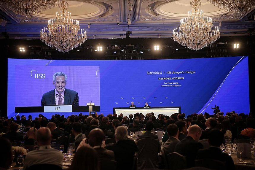 """Prime Minister Lee Hsien Loong at a question and answer session after delivering the keynote address at the Shangri-La Dialogue last night. PM Lee said it is natural that the United States and China will """"vie for power and influence, but competition"""