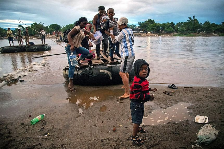 Migrants from Africa and Haiti entering Mexican territory along the banks of the Suchiate River on the Mexico-Guatemala border on Thursday. PHOTO: EPA-EFE A group of migrants apprehended in the US after crossing the border from Mexico on Wednesday, i