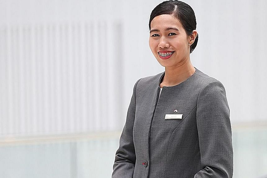 Ms Nurul Syuhaidah Senin was promoted from guest service officer to front office assistant manager in February and got a pay rise, after her job was redesigned. PHOTO: THE BUSINESS TIMES