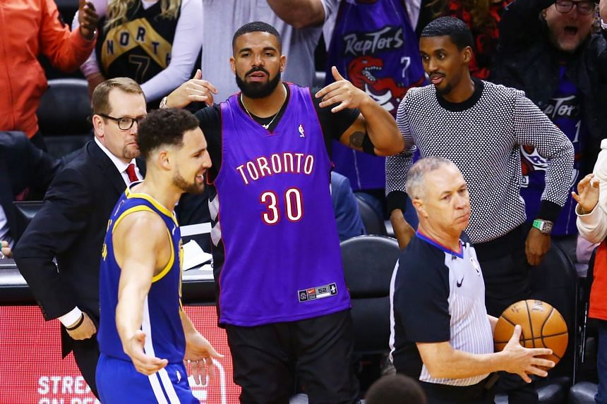 Drake reacts during Game One of the 2019 NBA Finals between the Warriors and the Raptors.