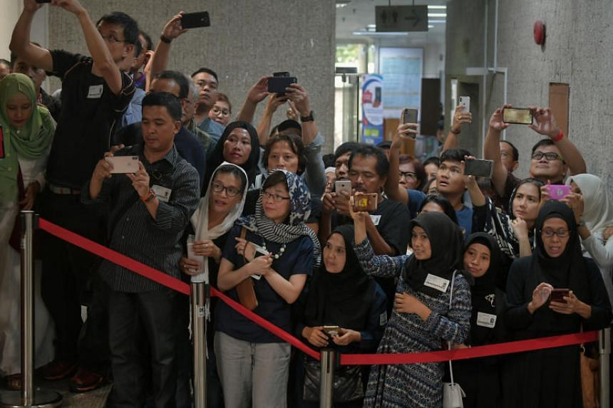Members of the public at the wake of Ani Yudhoyono, wife of Indonesia's former president Susilo Bambang Yudhoyono, at the Indonesian Embassy.