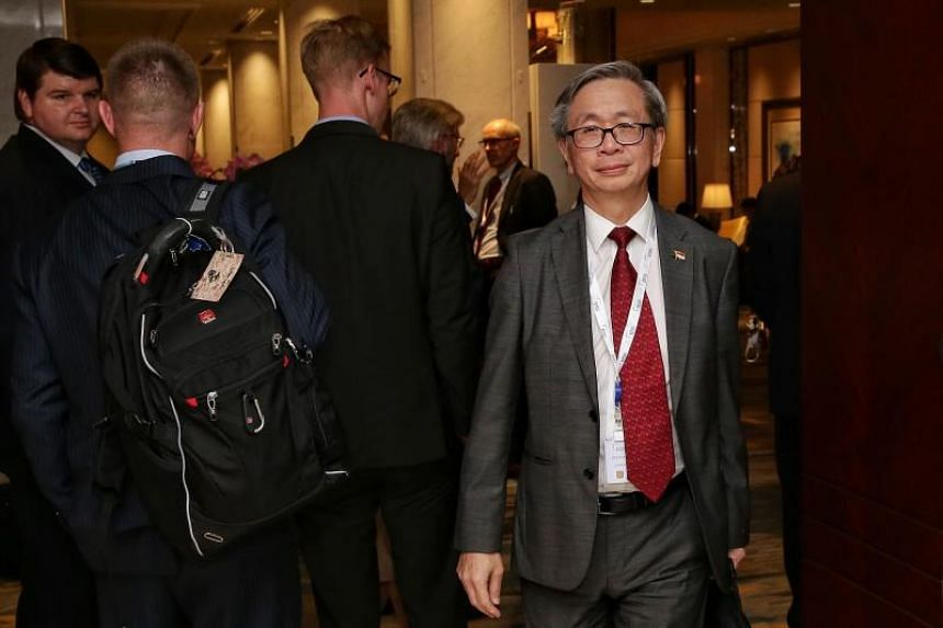 """Mr David Koh, chief executive of Singapore's Cyber Security Agency, taking his leave after the special session """"Cyber-Capability Development: Defence Implications"""" at the Shangri-La Dialogue on June 1, 2019."""