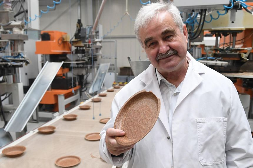 Polish inventor and entrepreneur Jerzy Wysocki holds a wheat bran plate in his factory Biotrem in Zambrow, Poland, on May 29, 2019.