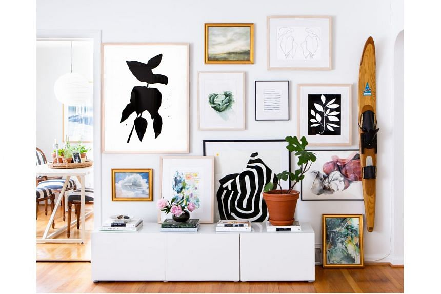A gallery wall by online company Artfully Walls at a home in Ann Arbor, Michigan.