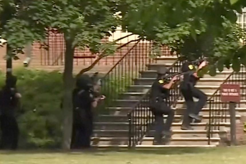 Police enter a building in this still image taken from video following a shooting incident at the municipal center in Virginia Beach on May 31, 2019.