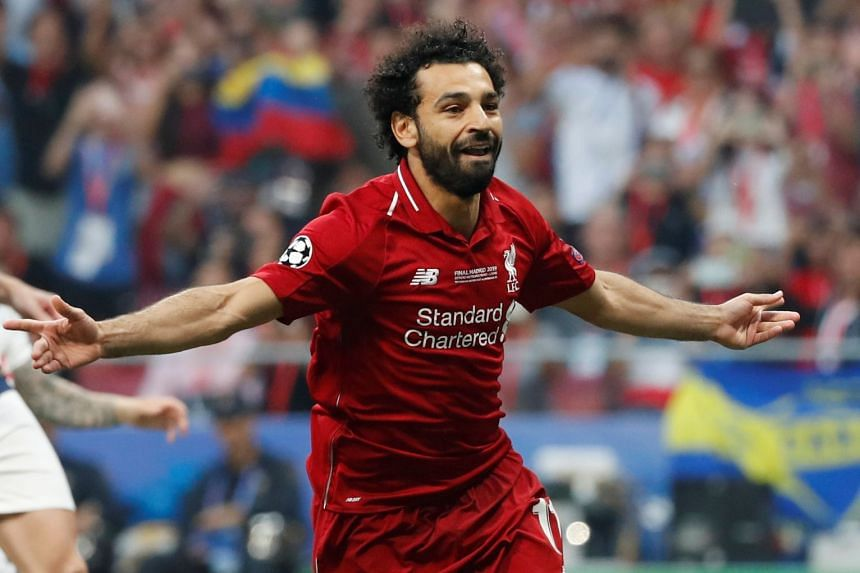 Liverpool's Mohamed Salah celebrates scoring their first goal from the penalty spot.