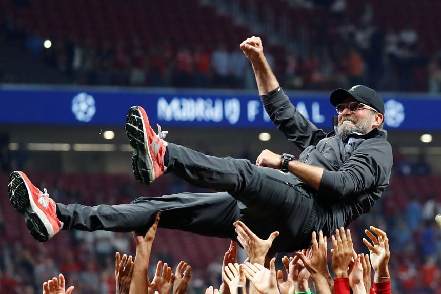 Liverpool manager Juergen Klopp is thrown in the air by the players as they celebrate after winning the Champions League.