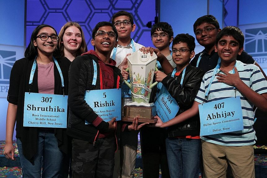 The eight spelling champions are (from left) Shruthika Padhy, Erin Howard, Rishik Gandhasri, Christopher Serrao, Saketh Sundar, Sohum Sukhatankar, Rohan Raja and Abhijay Kodali. The winning spellers made history with the most number of co-champions i