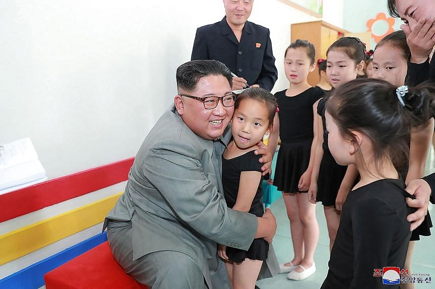 Another undated picture released by KCNA showing Mr Kim interacting with a group of girls during his visit to the 250-mile Journey for Learning Schoolchildren's Palace in Jagang province.