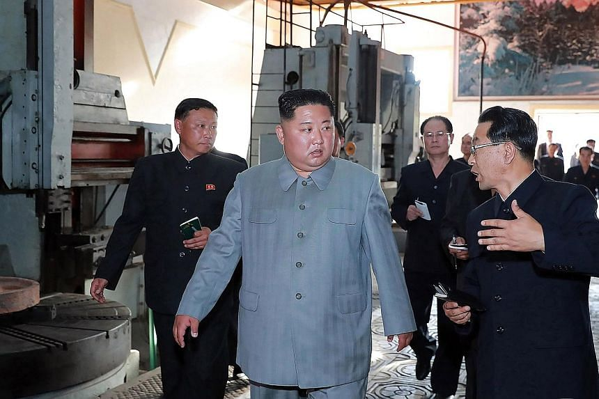 This undated picture released by the official Korean Central News Agency (KCNA) yesterday shows leader Kim Jong Un visiting Jangjagang Machine Tool Factory in Jagang province, North Korea. The news agency did not say when the visit happened.