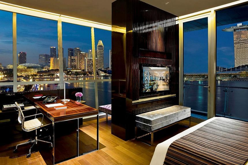 Fullerton Bay Hotel boasts suites (above) that overlook Marina Bay Sands and premier bay view rooms with jacuzzi.