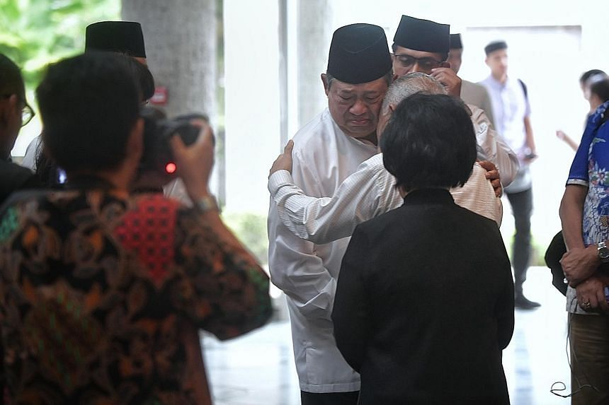 Dr Yudhoyono greeting well-wishers at the Indonesian Embassy yesterday after the final prayer rites for his late wife.