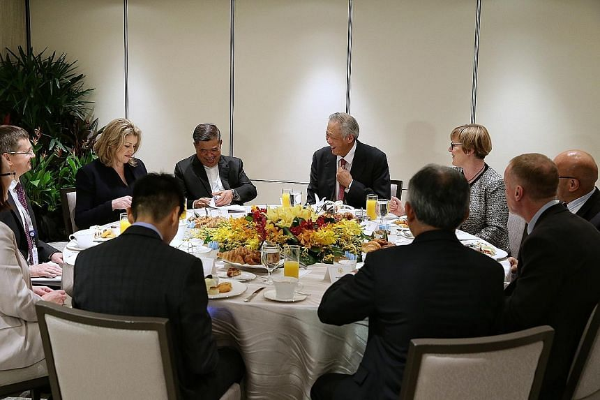 Singapore's Defence Minister Ng Eng Hen (centre) having breakfast with his counterparts from the Five Power Defence Arrangements (FPDA) member nations - (from left) Ms Penny Mordaunt of the United Kingdom, Mr Mohamad Sabu of Malaysia, Ms Linda Reynol