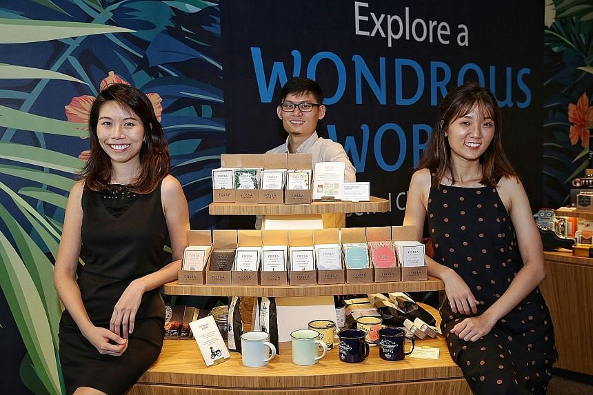 Fossa Chocolate founders (from left) Yilina Leong, 28, Jay Chua, 31, and Charis Chia, 25, with their products at Gift by Changi Airport at Jewel Changi Airport. Mr Ho Mun Choon, 23, a retail assistant, with a sealed packet of red bean pastry from Ton