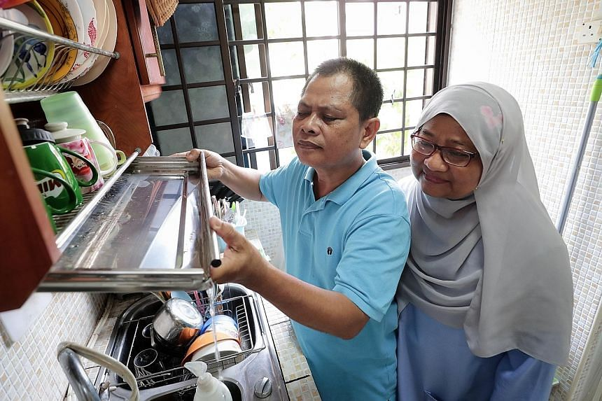 Chai Chee Road resident Zainodin Mohamad, 56, and his wife, Madam Sumarni Surana, 55, checking their kitchen for potential mosquito breeding habitats. The Chai Chee Road area is the third largest dengue cluster in Singapore. The first two are in Wood