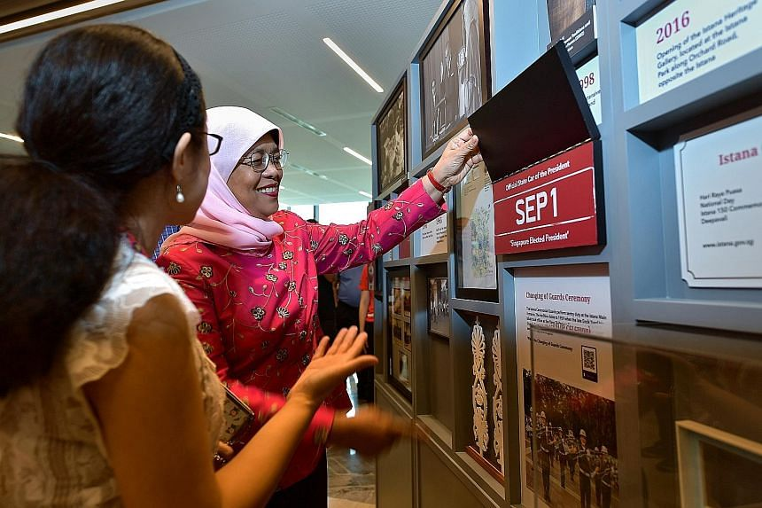 President Halimah Yacob at the roving exhibition, Our Istana: A Living Museum, which was launched at the Tampines Regional Library yesterday. ST PHOTO: NG SOR LUAN