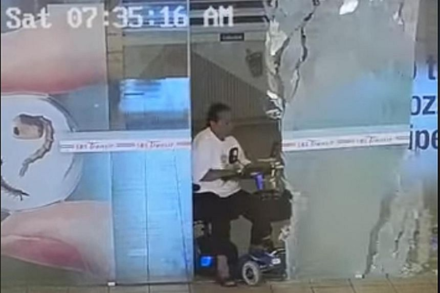 Screen grabs of a video posted on SBS Transit's Facebook page show the rider hitting one of a pair of glass doors at Toa Payoh bus interchange before they can fully open. She then appears to wheel the scooter away.