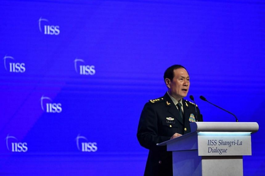 China's Defence Minister General Wei Fenghe speaking at the Fourth Plenary Session: China and International Security Cooperation during the IISS Shangri-La Dialogue 2019 at Shangri-La Hotel on June 2, 2019.