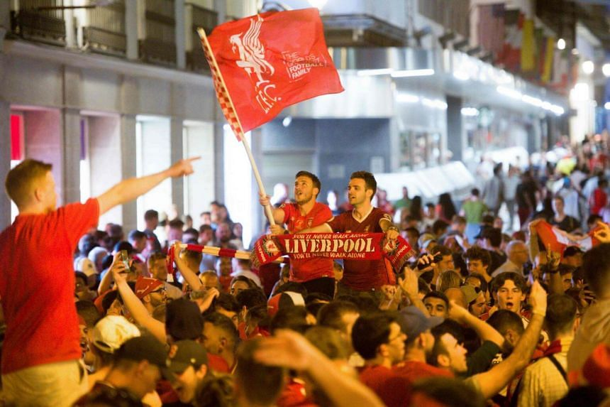 Liverpool supporters celebrate their team's win against Tottenham Hotspur during the Uefa Champions League final football match at Plaza Mayor in Madrid, on June 2, 2019.