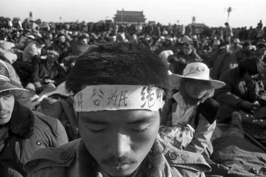 A student practicing qigong, the age-old practice of cultivating energy flow, while on a hunger strike during the Tiananmen Square Protest in Beijing in 1989.