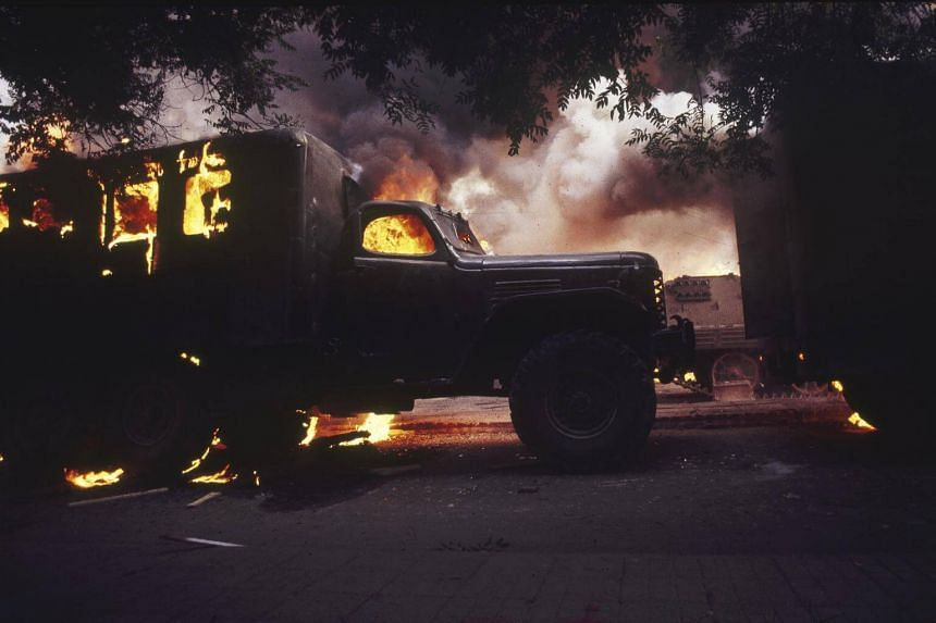 Military vehicles burning on West Chang'An Avenue during the Tiananmen Square Protest in Beijing in May of 1989.