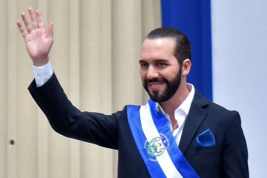 Bukele waves during his inauguration ceremony at a square in downtown San Salvador.