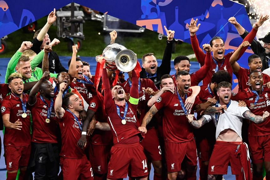 Liverpool's players celebrate with the trophy.
