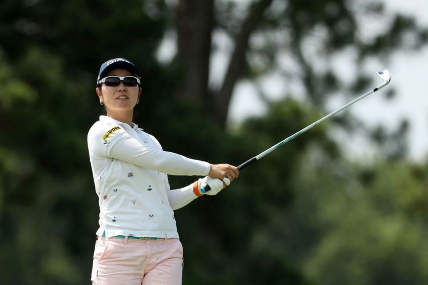 Mamiko Higa of Japan hits a tee shot on the 17th hole during the second round.