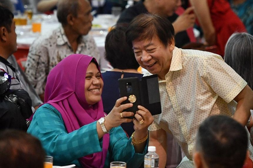 Coordinating Minister for Infrastructure & Minister for Transport, Mr Khaw Boon Wan poses for a wefie with a resident.