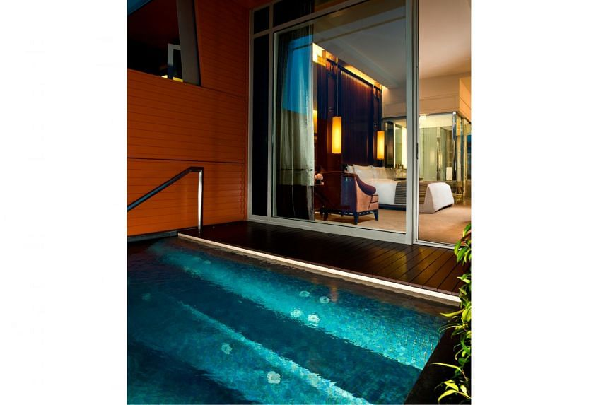 Fullerton Bay Hotel boasts suites that overlook Marina Bay Sands and premier bay view rooms with jacuzzi (above).