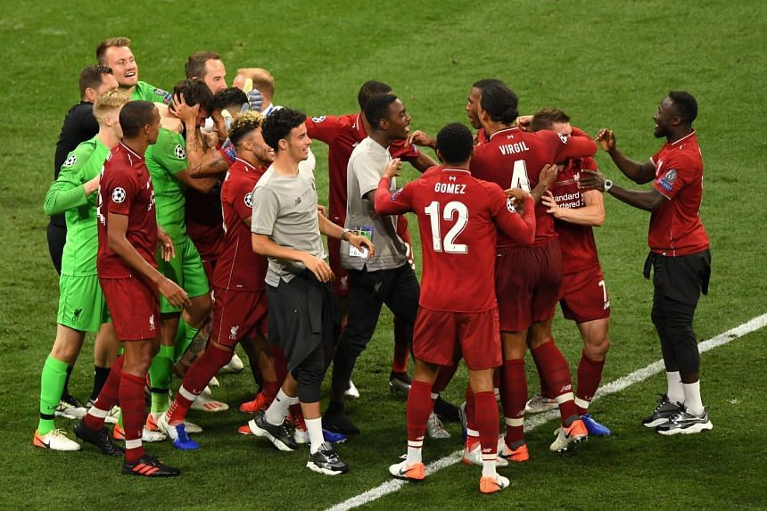 Liverpools players celebrate after the match.