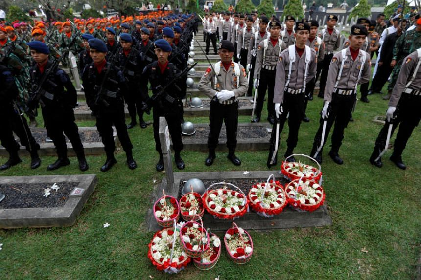 Flower baskets are pictured during the funeral ceremony of the late former Indonesian First Lady Ani Yudhoyono at Kalibata Heroes Cemetery complex in Jakarta on June 2, 2019.