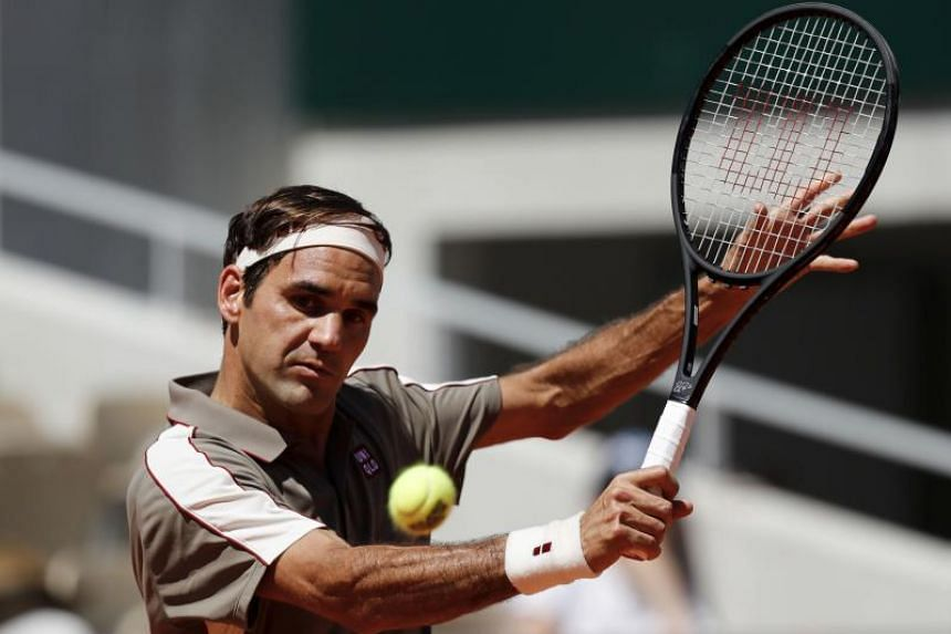 Roger Federer plays a forehand return during the men's singles fourth round match at The Roland Garros 2019 French Open tennis tournament in Paris on June 2, 2019.