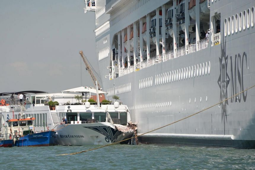 The cruise ship MSC Opera (right) is seen after the collision with a tourist boat, in Venice on June 2, 2019.