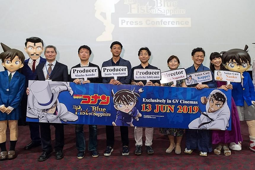 The film's mascots with (from left) Mr Peter Go, managing director of Odex; producers Shuho Kondo, Isato Yonekura and Keiichi Ishiyama; director Chika Nagaoka; and voice actors Kappei Yamaguchi and Naoko Matsui.