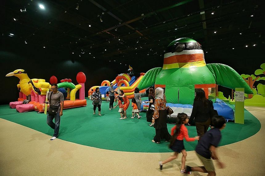 Kids can play on three bouncy castles shaped like birds at the Forest Playground at the National Museum of Singapore.