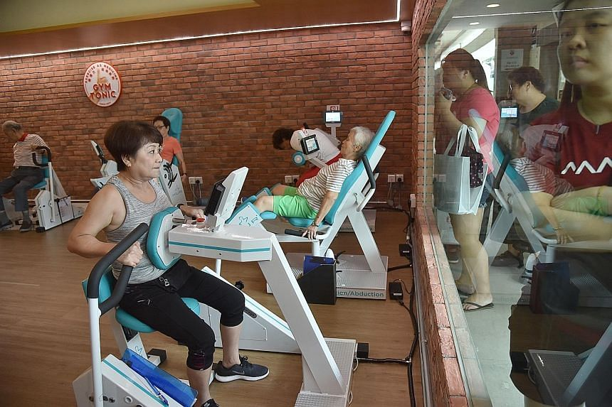 Residents doing strength training exercises in the Gym Tonic programme at the Touchpoint @ AMK 433 community hub, including Ms Rose Lee Kar Lan (in grey top), 61, and Ms Tan Yah Poh (in green shorts), 70.