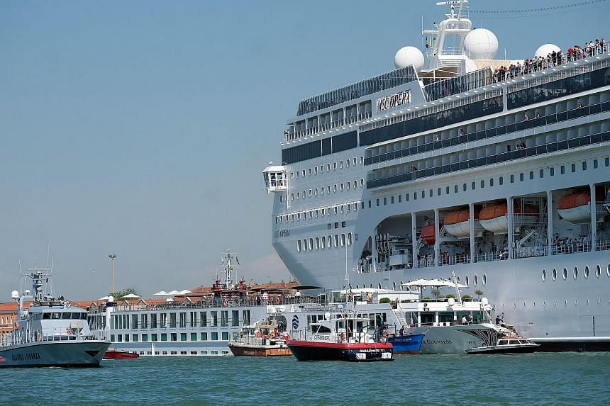 A cruise ship collided with a dock and a tourist boat in Venice yesterday, injuring four people, the local port authority said. MSC Cruises said the 2,679-passenger Opera, a 54m-tall and 275m-long liner which dwarfed the Venice skyline, was approachi