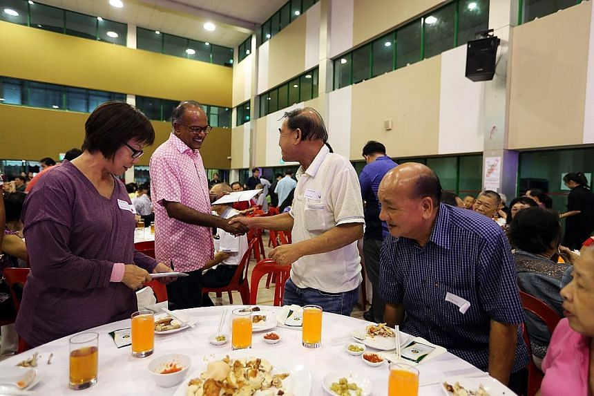 Transport Minister Khaw Boon Wan giving a resident her Merdeka Generation Package at ACE The Place Community Club in Woodlands yesterday, where 250 Sembawang GRC residents received their packages. ST PHOTO: CHONG JUN LIANG Home Affairs and Law Minist