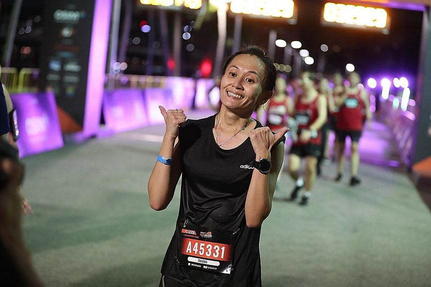 Runners dashing off for the full and half marathons in the Sundown Marathon on Saturday; Kenyan Hillary Kipkering and Singapore's Sharon Tan (above) giving the race - and themselves - the thumbs up after winning the men's and women's full races.