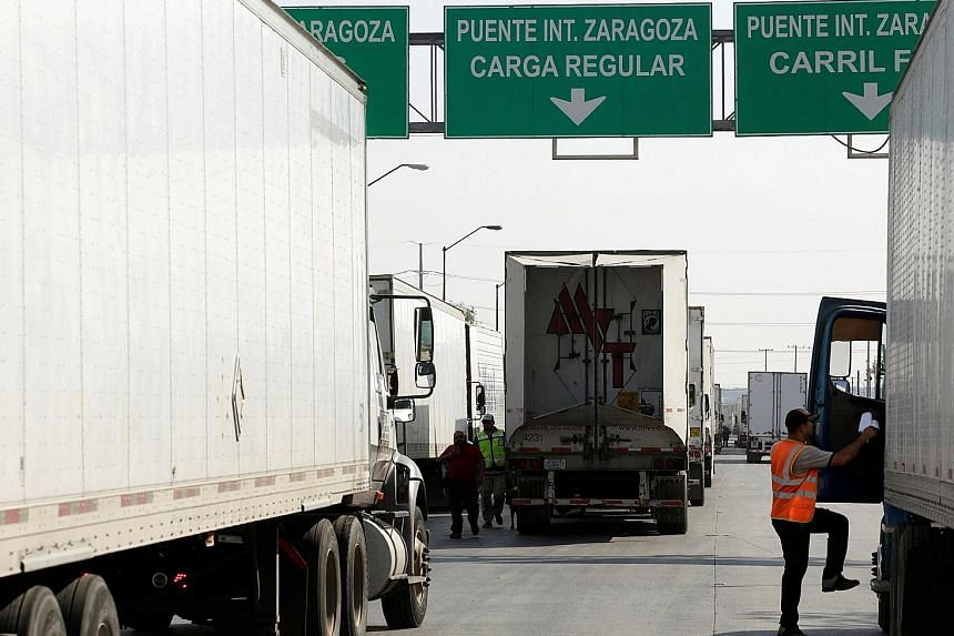 Trucks wait in a queue to cross into the United States at the Zaragoza-Ysleta border crossing in Ciudad Juarez, Mexico. Uncertainty rules the markets as US President Donald Trump slapped bans on Chinese telecommunications equipment maker Huawei and threat