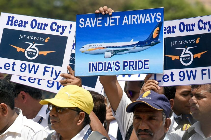 India's Jet Airways employees hold placards during a silent protest in Mumbai on May 3, 2019 after the debt-stricken airline halted all its operations.