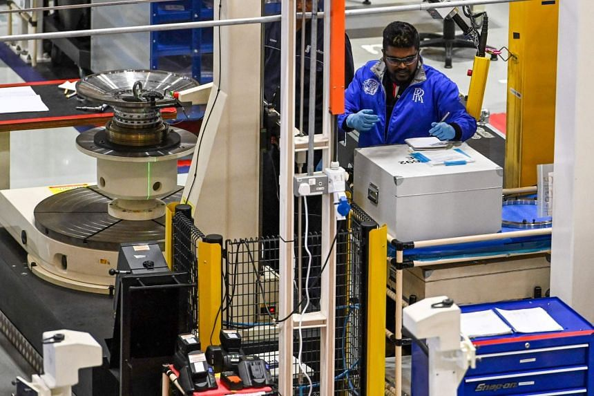 A technician working at the Rolls-Royce engine rotor assembly facility in Singapore on March 18, 2019.