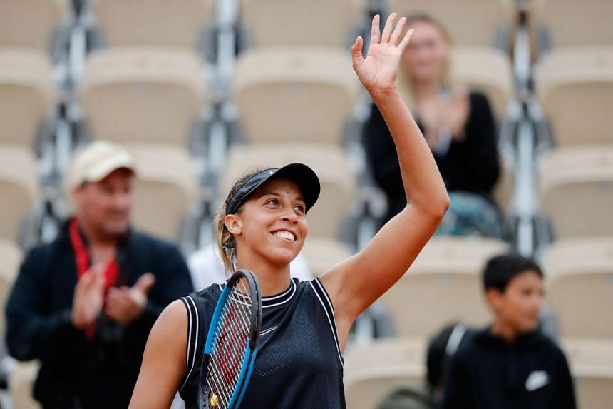 Madison Keys of the US celebrates after winning against Czech Republic's Katerina Siniakova at the end of their women's singles fourth round match on day nine of The Roland Garros 2019 French Open tennis tournament in Paris on June 3, 2019.